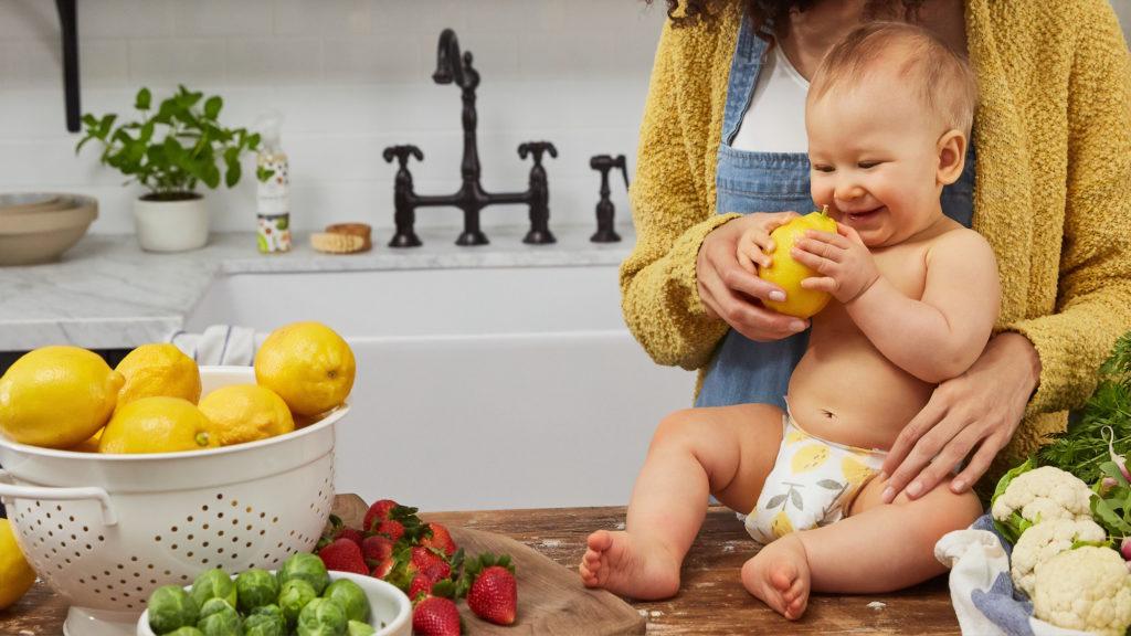 baby holding lemon